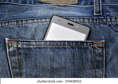 Mobile phone, cellphone in back pocket blue jeans.
