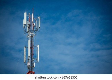 Mobile phone communication antenna tower with the blue sky and clouds, Telecommunication tower