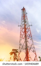 mobile phone communication and network signal repeater antenna tower with blue sky background. Sun light effect.