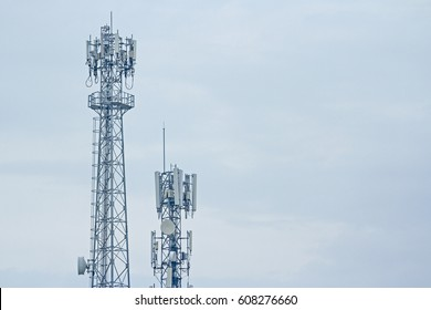Mobile phone communication two tower transmission  signal with blue sky background and antenna