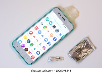 Mobile phone and a condom, dating apps, sex apps, meeting apps, porn apps, pornography in the phone, porn in mobile phone