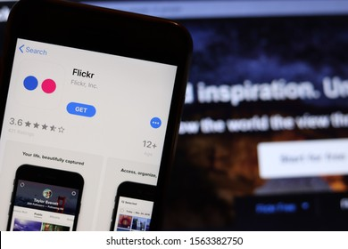 Mobile phone with Flickr app icon on screen close up with website on laptop. Blurred background with Flickr. Los Angeles, California, USA - 9 November 2019, Illustrative Editorial