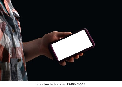 Mobile phone in the hand of a teenager, mocap copy space, hand in the shade