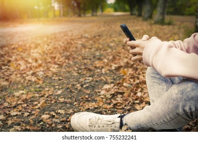 mobile phone hands in the fall outdoors