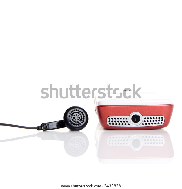 Mobile phone and headphones isolated on white