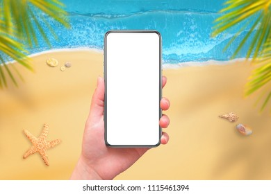 Mobile phone with isplated screen for mockup in woman hand. Beach and sea in background. Travel app design presentation.
