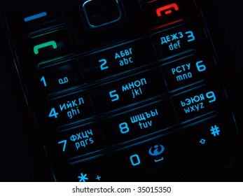 Mobile phone keypad back lit macro image on black