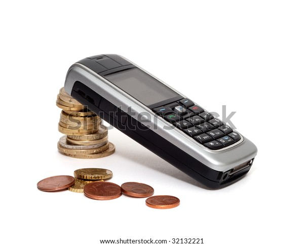 mobile phone laying on column of coins with several euro cents in front over white