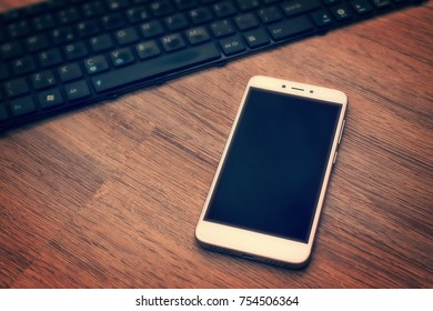 mobile phone lying on a keyboard table