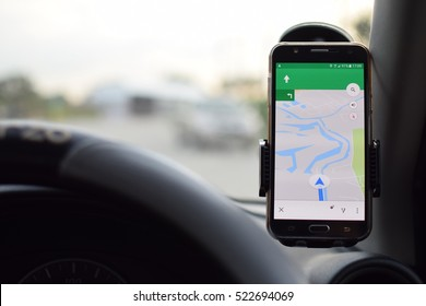 mobile phone with map gps navigation in car.