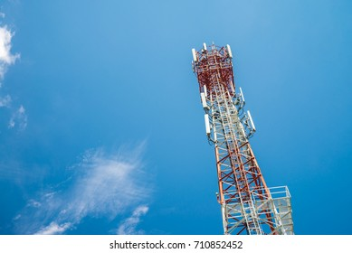 Mobile phone mast tower on blue sky background - mobile network concept
