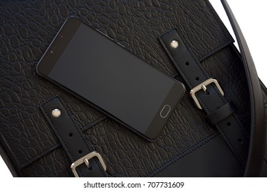 mobile phone on the black leather bag