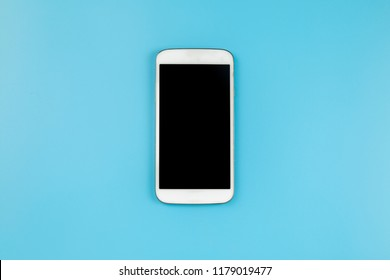 Mobile phone on blue background pastel style flatlay topview copyspace clipping path at screen