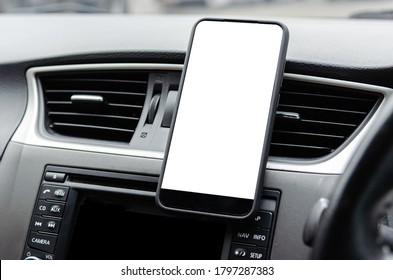 Mobile phone on the car air vent.Blank with white screen.