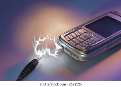 A mobile phone on charge, good background