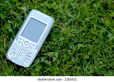 A Mobile phone on the grass