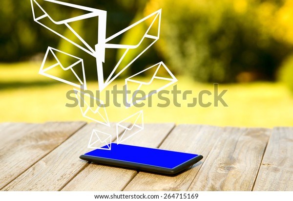 Mobile phone placed on wooden floor with nature background
