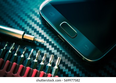Mobile Phone Repair and Upgrade. Smartphone Repairing Concept Photo.