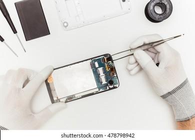 mobile phone repairing, flat lay, top view