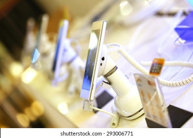mobile phone in shop, electronics internet and communication network service business, Digital gadget and smartphone in electronic store.