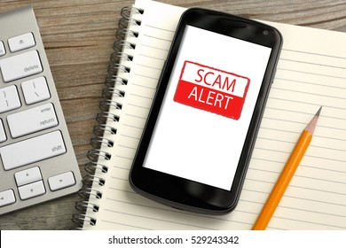mobile phone showing scam alert warning