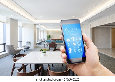 mobile phone with smart home apps in modern meeting room
