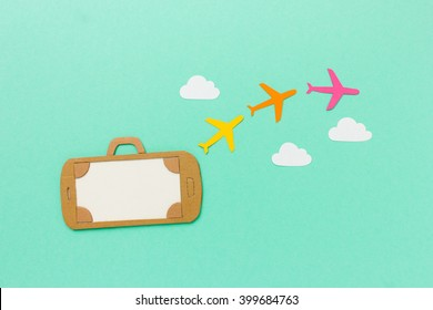 Mobile phone suitcase illustration with colorful paper airplanes flying through the clouds - travel planning, flight booking concept - airport luggage online check-in with space for text