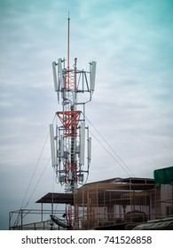 Mobile phone towers and 4G system installed on the roof 3G house in the community.