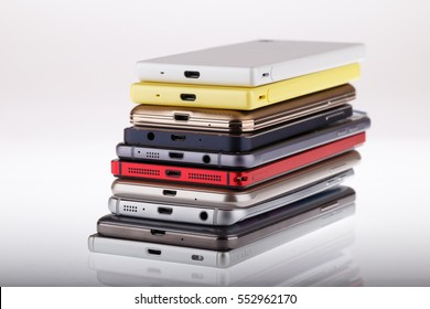 Mobile phone wireless communication technology and mobility business office concept - group of smartphones on white background