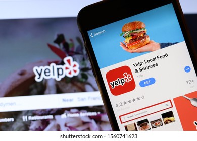 Mobile phone with Yelp icon on screen close up with website on laptop. Blurred background with Yelp logo. Los Angeles, California, USA - 9 November 2019, Illustrative Editorial