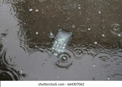 Mobile phones on the sand under the water.