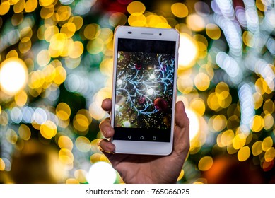 Mobile phones are used to take pictures on Christmas day.blur