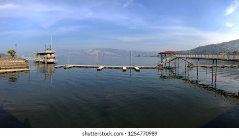 Mobile photography panorama of docks and a boat at Clear Lake in Northern California. Also spelled Clearlake sometime, this body of water is California's largest for freshwater.