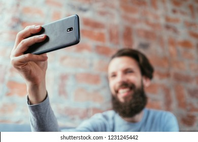 mobile photography. technology and digital devices. man taking selfie using phone.