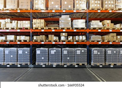 Mobile shelving system with goods in warehouse