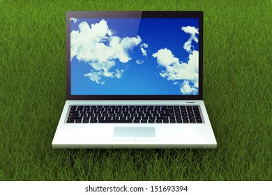 Mobile silver laptop on the grass. Connection to the internet anywhere.