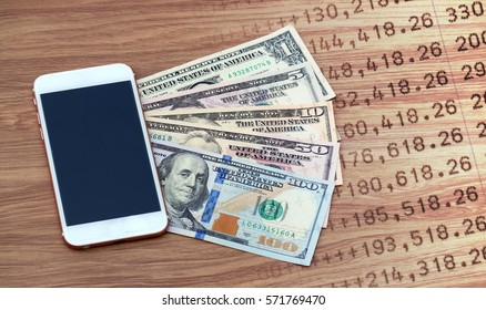 Mobile Smart phone and dollar cash with bank statement, digital money and fintech concept. Double exposure.
