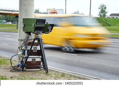 Mobile speed camera on highway. Police radar installed on roadside to control speed limit. Police radar on the road. Automatic radar photographs cars driving too fast