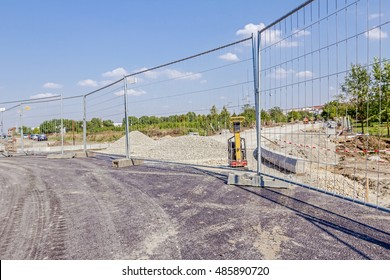 Mobile steel fence as a barrier. Restricted area, for the authorized personnel only. Construction site has a safety rules.