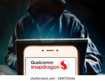 Mobile system on a chip (SoC) made by Qualcomm, Qualcomm Snapdragon, logo is seen on an Android mobile device with a figure of hacker in the background.