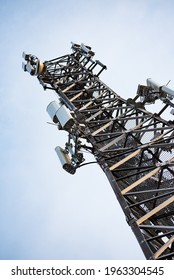 Mobile telephony base station. Metal mast structure with devices transmitting electromagnetic waves. 3G, LTE and 5g networks.