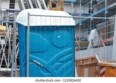 A mobile toilet on a construction site