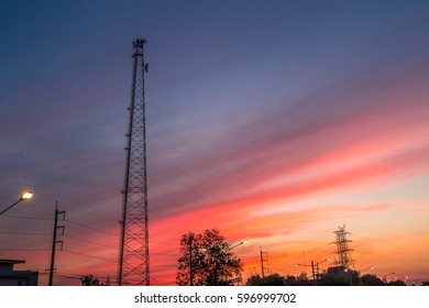 Mobile tower silhouette with twilight evening sky.