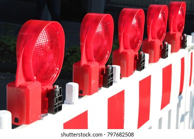 mobile traffic barrier with red warning lights at construction site