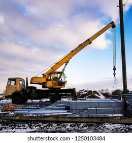 Mobile, truck, jib, boom, wrecler crane.Building ambulatory in Ukraine village.