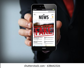 mobility news concept: businessman hand holding a touch phone with fake news on a screen