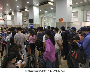 MOC BAI, VIETNAM - MARCH 19, 2020: Unidentified Vietnamese citizens wait at the Moc Bai border point to be transported to a quarantine facility on the second day of border lockdown.