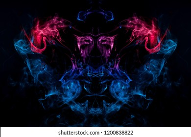 Mocap for cool t-shirts. Dense multicolored smoke of   blue and purple colors in the form of a skull, monster, dragon on a black isolated background. Background of smoke vape.