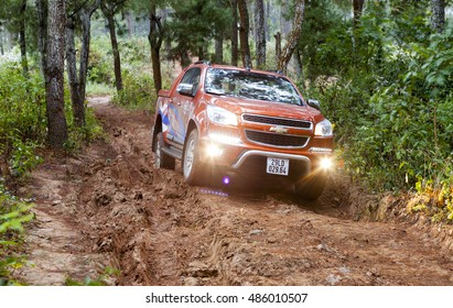 Mocchau, Vietnam - Jan 9, 2015: Chevrolet Colorado pick-up car running on the off-road in test drive in Vietnam.