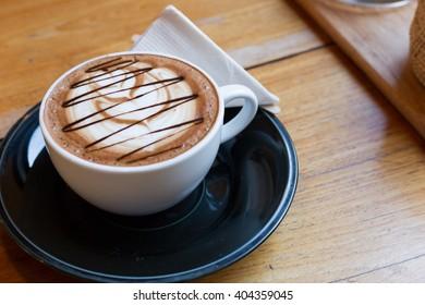Mocha coffee in the wood table